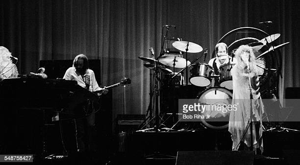 From left British musicians Christine McVie John McVie Mick Fleetwood and Stevie Nicks of the group Fleetwood Mac perform onstage at the Los Angeles...