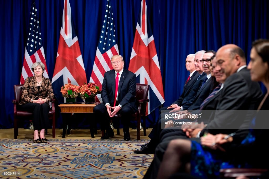 British Prime Minister Theresa May, US President Donald Trump, US Vice President Mike Pence, US Secretary of State Rex Tillerson, US Secretary of the Treasury Steven Mnuchin and others wait for a meeting at the Palace Hotel, on the sidelines of the 72nd United Nations General Assembly in New York City on September 20, 2017. / AFP PHOTO / Brendan Smialowski