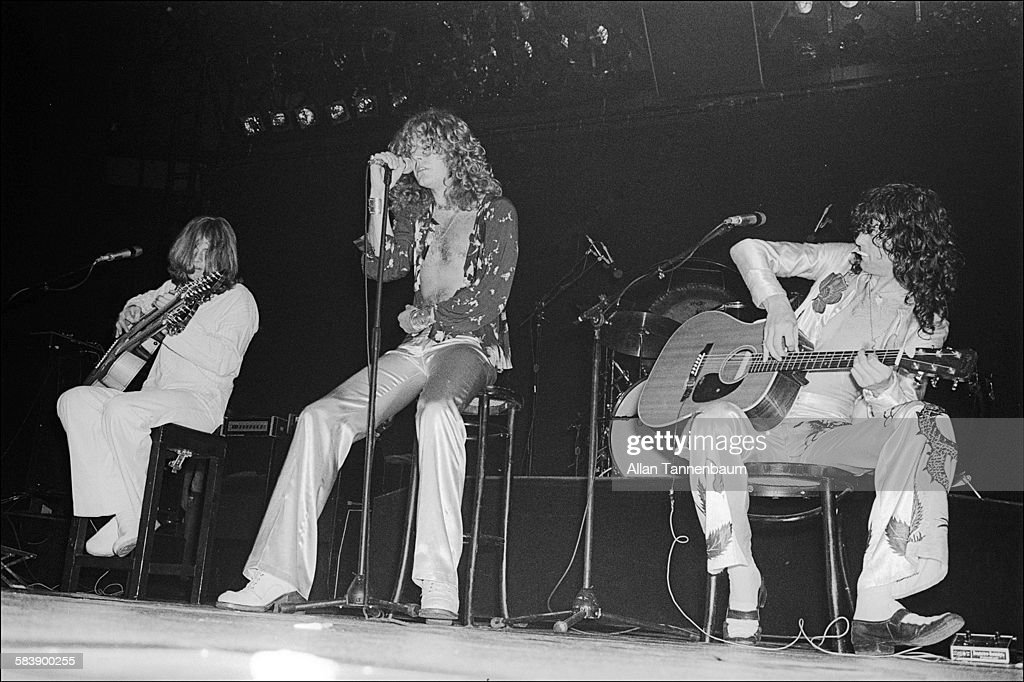 From left, British Rock musicians John Paul Jones, Robert Plant, and Jimmy Page, of the group Led Zeppelin, perform at Madison Square Garden, New York, New York, June 10, 1977.