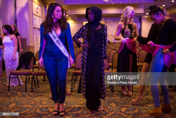 From left Brooke Harris Miss Maine USA 2017 helps Hamdia Ahmed practice her poses before the first night of the Miss Maine USA pageant Ahmed's big...
