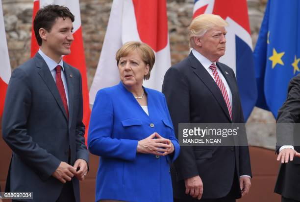 Canada's Prime Minister Justin Trudeau Germany's Chancellor Angela Merkel and US President Donald Trump pose for a family photo at the Greek Theatre...