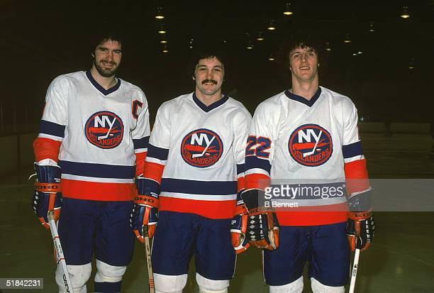 From left Canadian ice hockey players Clark Gillies Bryan Trottier and Mike Bossy of the New York Islanders pose together on the ice in March of 1979...