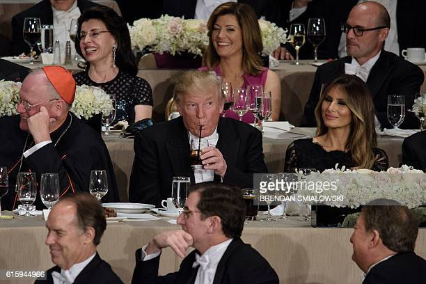 From left Cardinal Timothy Dolan Archbishop of New York Republican presidential nominee Donald Trump Melania Trump and others listen as Democratic...
