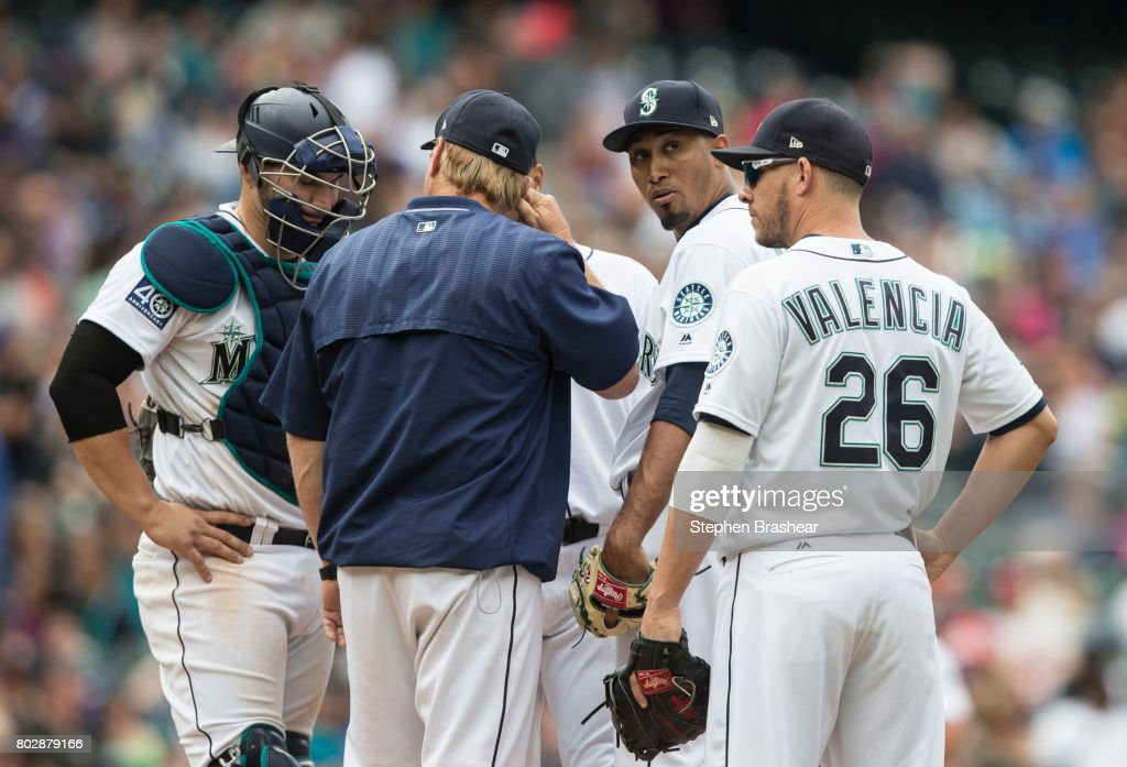 From left, catcher Mike Zunino #3 of the Seattle Mariners, pitching coach Mel Stottlemyre Jr., relief pitcher Edwin Diaz #39 of the Seattle Mariners and first baseman Danny Valencia #26 of the Seattle Mariners meet at the mound after Diaz gave up a game-tying home run and walked the following batter during the ninth inning interleague game against the Philadelphia Phillies at Safeco Field on June 28, 2017 in Seattle, Washington. The Phillies won 5-4.