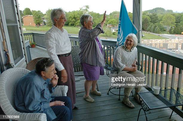 From left Catherine Runschlag Dene Peterson Kathleen Hutson and Monica Appleby waved to a friend from Catherine and Kathy's porch overlooking the...