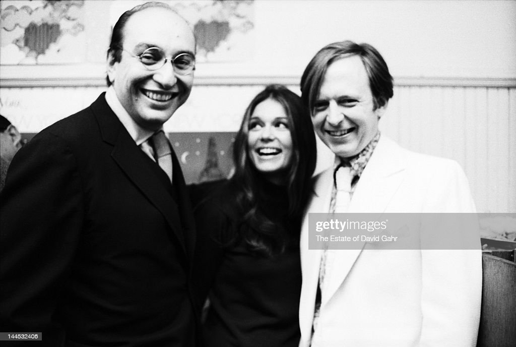 Celebrated graphic designer Milton Glaser, author and activist Gloria Steinem, and author and journalist Tom Wolfe pose for a portrait at a New York Magazine party on November 7, 1967 in New York City, New York.