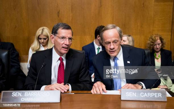 From left chairman John Barrasso RWyo and ranking member Tom Carper DDel talk before the start testimony from Andrew Wheeler acting administrator at...