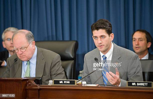 From left chairman John Spratt DSC listens as ranking member Paul Ryan RWisc makes his opening statement during the House Budget Committee hearing on...