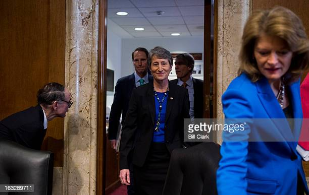 From left chairman Ron Wyden DOre Sally Jewell nominee to be Interior Secretary Sen Mark Udall DColo and Sen Lisa Murkowski RAlaska arrive for...