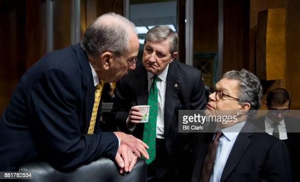 From left Chairman Sen Chuck Grassley RIowa speaks with Sen John Kennedy RLa and Sen Al Franken DMinn during the Senate Judiciary Committee...