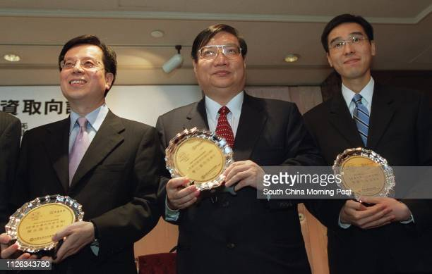 Chan Wingluk Cho Yanchiu and Kenny Tang attend a press conference on a local investment preference survey conducted by the Association of...