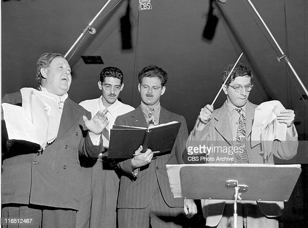 From left Charles Laughton Charles Levin Norman Corwin and conductor Bernard Herrmann during Columbia Presents Corwin radio program at the KNX...