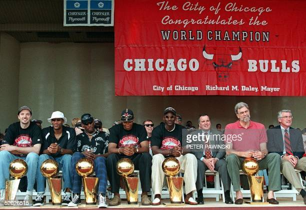 From left Chicago Bulls players Toni Kukoc Ron Harper Dennis Rodman Scottie Pippen and Michael Jordan sit with Chicago Mayor Richard Daley Bulls head...
