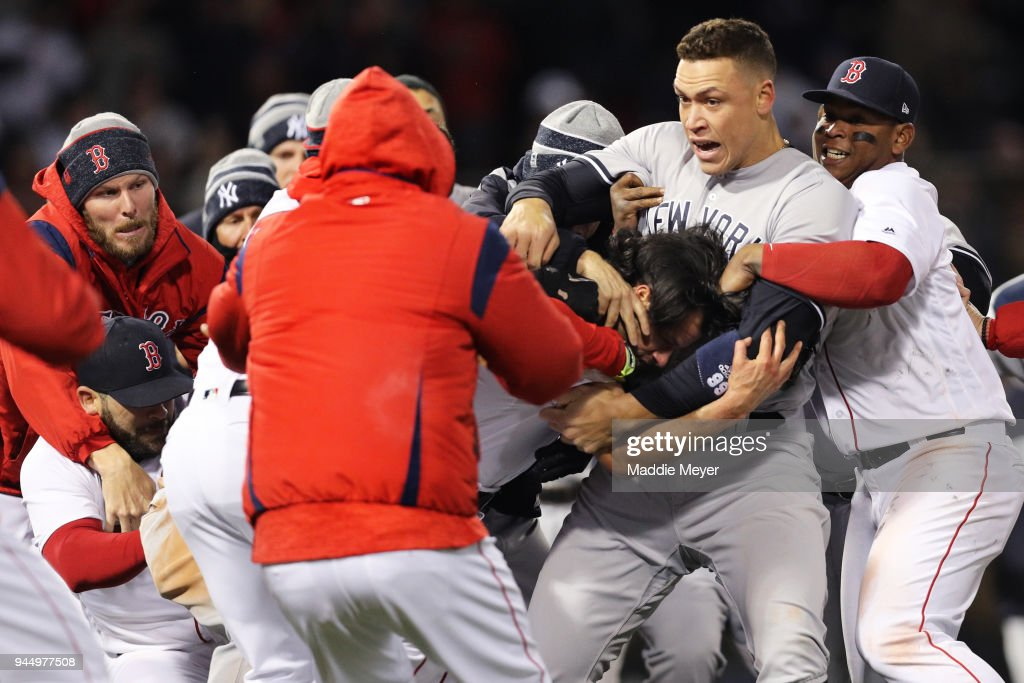 From left, Chris Sale #41 of the Boston Red Sox, Aaron Judge #99 of the New York Yankees and Rafael Devers #11 work to separate a fight involving Joe Kelly #56 of the Boston Red Sox and Tyler Austin #26 of the New York Yankees during the seventh inning at Fenway Park on April 11, 2018 in Boston, Massachusetts. Austin rushed the mound after being struck by a pitch thrown by Kelly.