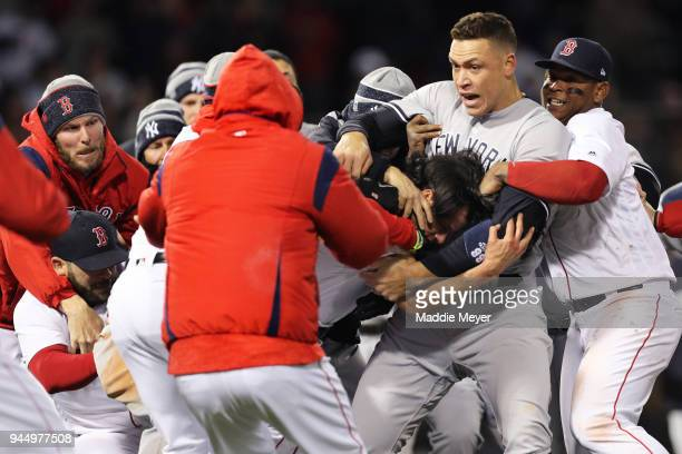 From left Chris Sale of the Boston Red Sox Aaron Judge of the New York Yankees and Rafael Devers work to separate a fight involving Joe Kelly of the...