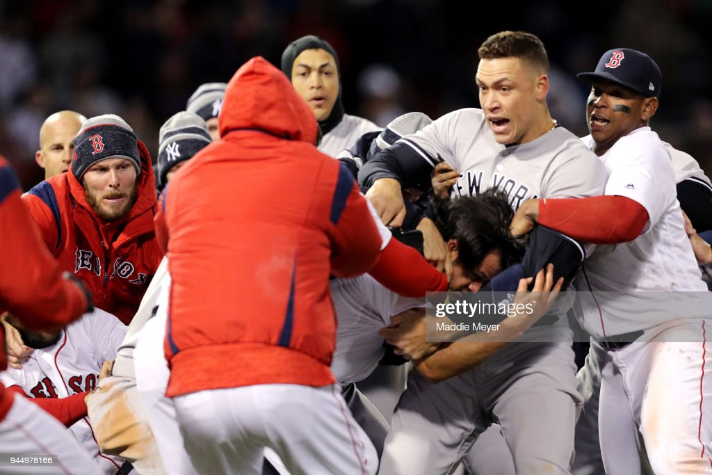 From left, Chris Sale #41 of the Boston Red Sox, Giancarlo Stanton #27 of the New York Yankees, Aaron Judge #99 of the New York Yankees and Rafael Devers #11 of the Red Sox work to separate a fight involving Joe Kelly #56 of the Boston Red Sox and Tyler Austin #26 of the New York Yankees during the seventh inning at Fenway Park on April 11, 2018 in Boston, Massachusetts. Austin rushed the mound after being struck by a pitch thrown by Kelly.