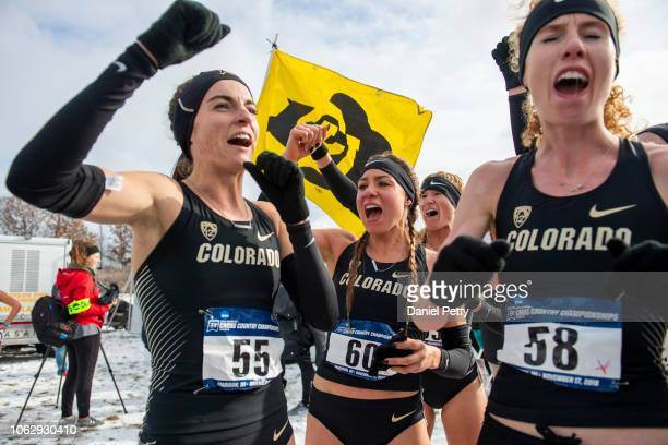 From left Colorado senior Dani Jones senior Taylor Tuttle and junior Tabor Scholl react after winning the NCAA cross country championship team title...