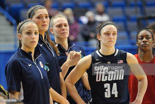 From left Connecticut's Caroline Doty Stefanie Dolson Heather Buck Kelly Faris and Brianna Banks watch the awards ceremony after a 6159 loss to Notre...