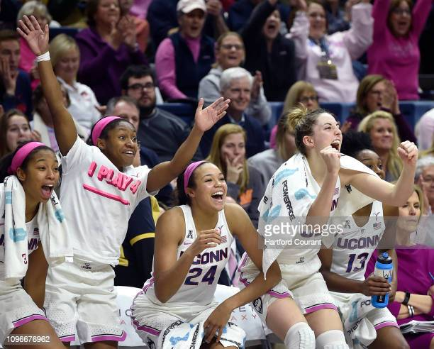 From left, Connecticut's Megan Walker, Crystal Dangerfield, Napheesa Collier, and Katie Lou Samuelson celebrate from the bench against Temple at...