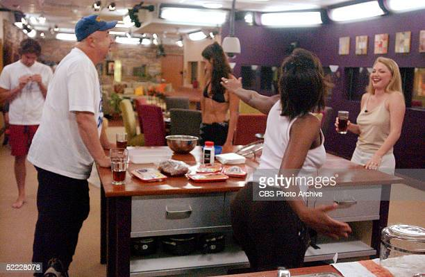 Contestants Jason Guy Gerry Lancaster Lisa Donahue Danielle Reyes and Amy Crews gather in the kitchen of the Big Brother house during an episode of...