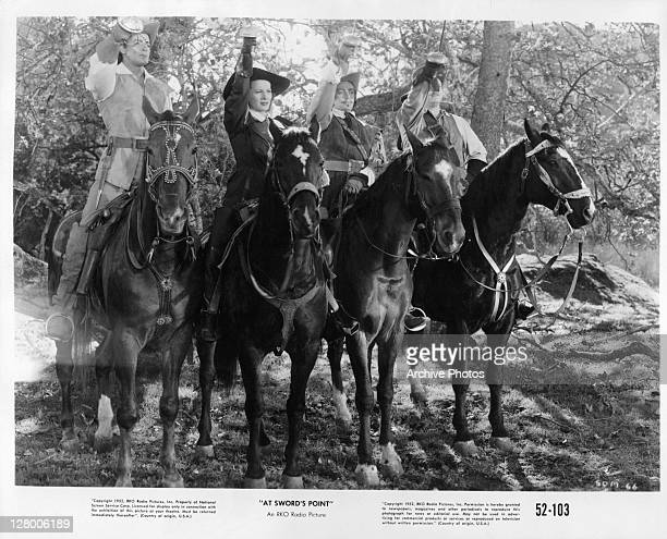 From left, Cornel Wilde, Dan O'Herlihy, and Alan Hale Jr on horseback in a scene from the film 'At Sword's Point', 1952.