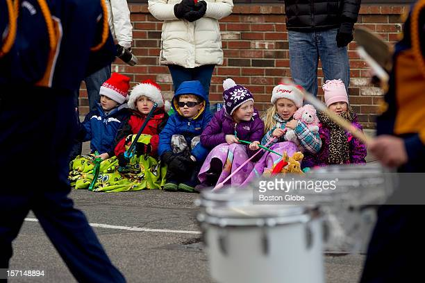 From left cousins Michael Riley Brendan Riley Tommy Regan Dianna Regan Mary Riley and Olivia Farrow sit and enjoy the Annual Christmas Parade in...