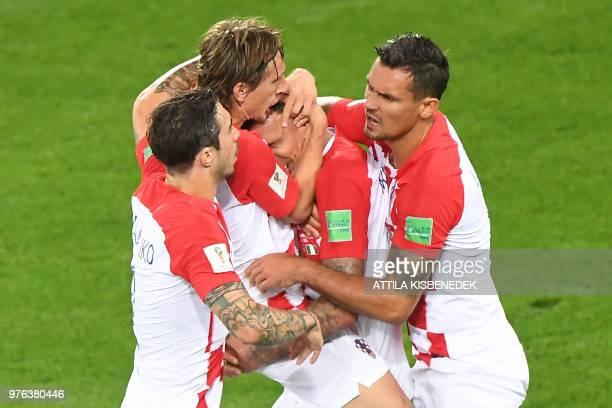 Croatia's defender Sime Vrsaljko Croatia's midfielder Luka Modric Croatia's forward Mario Mandzukic and Croatia's defender Dejan Lovren celebrate an...