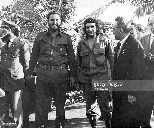 From left Cuban revolutionaries Premier Fidel Castro and National Bank President Ernesto Che Guevara share a laugh with Russian politician and Soviet...