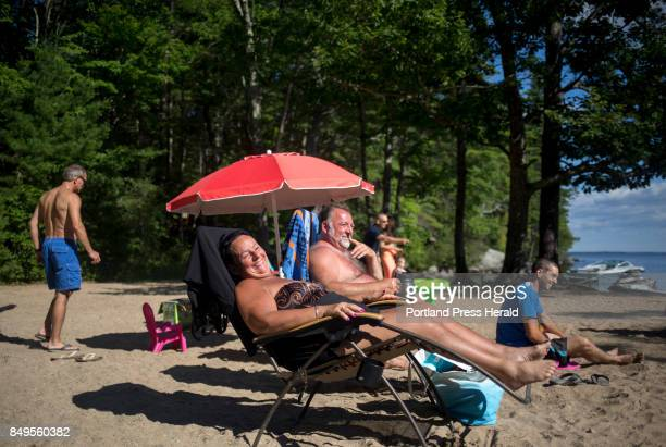 From left Danielle Belanger and Rene Veilleux relax with their family on one of the beaches near their campground at Sebago Lake State Park The...