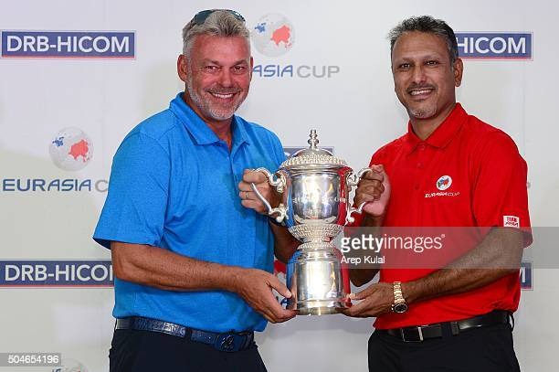 From left Darren Clarke Team Europe Captain and Jeev Milkha Singh Team Asia captain pose with the trophy during the press conference ahead of the...