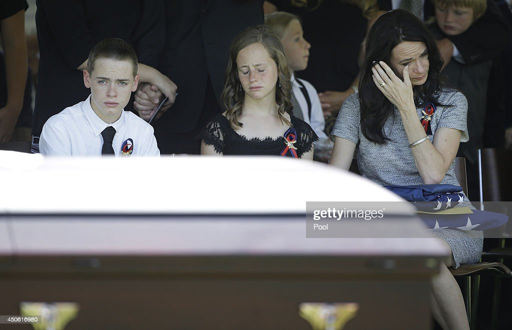 From left, Daxton Beck, Avenlee Beck and their mother Nicole Beck attend a memorial for Nicole Beck's husband Las Vegas Metropolitan Police Officer Alyn Beck at The Smith Center for the Performing Arts Saturday, on June 14, 2014 in Las Vegas, Nevada. Police said Beck and Officer Igor Soldo were shot and killed on June 8 at a restaurant by Jerad Miller and his wife Amanda Miller. Police said the Millers then went into a nearby Wal-Mart where Amanda Miller killed Joseph Wilcox before police killed Jerad Miller and Amanda Miller killed herself.