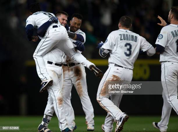 From left Dee Gordon of the Seattle Mariners and teammates Ryon Healy Jean Segura Mike Zunino and Mitch Haniger celebrate after Healy hit walkoff...