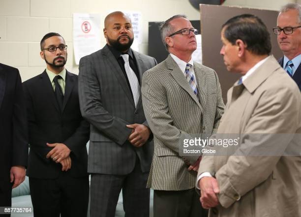 From left defendants John Raposo Derek Howard and George Billadeau stand in a waiting room during a visit to the Bridgewater State Hospital in...