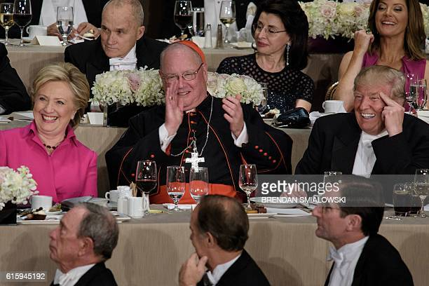 From left Democratic presidential nominee Hillary Clinton Timothy Cardinal Dolan Archbishop of New York and Republican presidential nominee Donald...