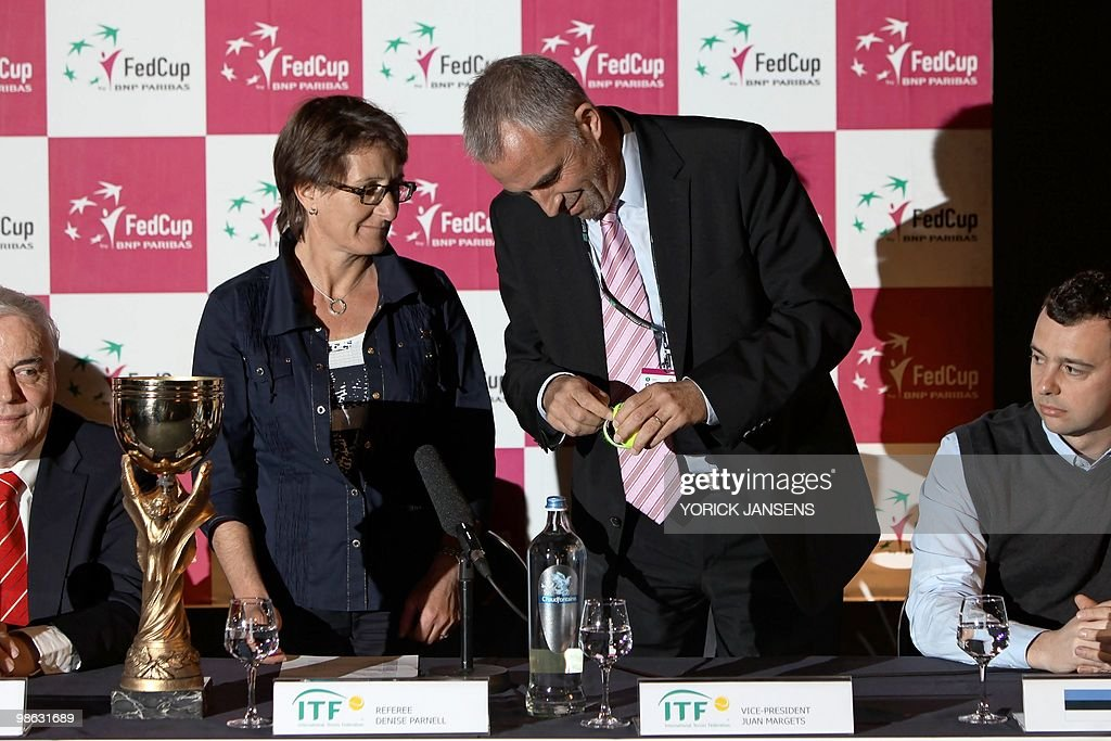 From Left Denise Parnell, International Tennis Federation (ITF) referee and Juan Margets, Vice-President ITF, attend the drawing for the Fed Cup opposing Belgium to Estonia, in Hasselt, on April 23, 2010. Henin has a broken finger and will only play the doubles game.