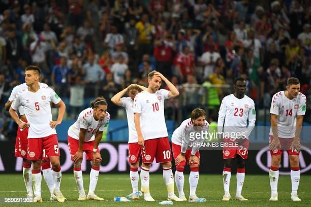 Denmark's defender Jonas Knudsen Denmark's forward Yussuf Poulsen Denmark's midfielder Christian Eriksen Denmark's midfielder Lasse Schone Denmark's...