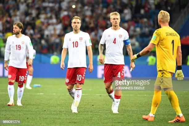 Denmark's midfielder Lasse Schone, Denmark's midfielder Christian Eriksen, Denmark's defender Simon Kjaer and Denmark's goalkeeper Kasper Schmeichel...