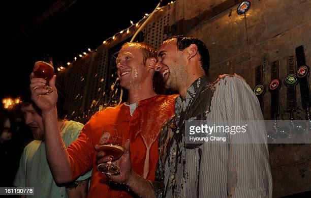 From left Denver Beer Co pays off playoff bet losing against Jack's Abby Brewing of Massachusetts by dumping beer on head honcho Casey Capper and...