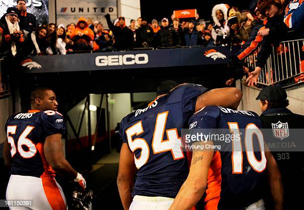 From left, Denver Broncos LB Robert Ayers, Andra Davis and Jabar Gaffney are leaving the filed after loosing the game against Kansas City Chiefs at...