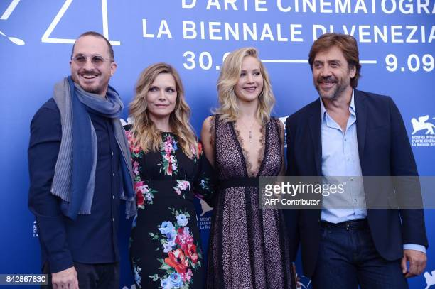 director Darren Aronofsky US actress Michelle Pfeiffer US actress Jennifer Lawrence and Spanish actor Javier Bardem attend the photocall of the movie...