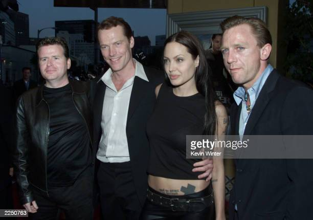 From left director Simon West and cast members Iain Glen Angelina Jolie and Daniel Craig before the premiere of the film 'Lara Croft Tomb Raider' at...