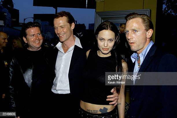 From left director Simon West cast members Iain Glen Angelina Jolie and Daniel Craig before the premiere of the film 'Lara Croft Tomb Raider' at Mann...