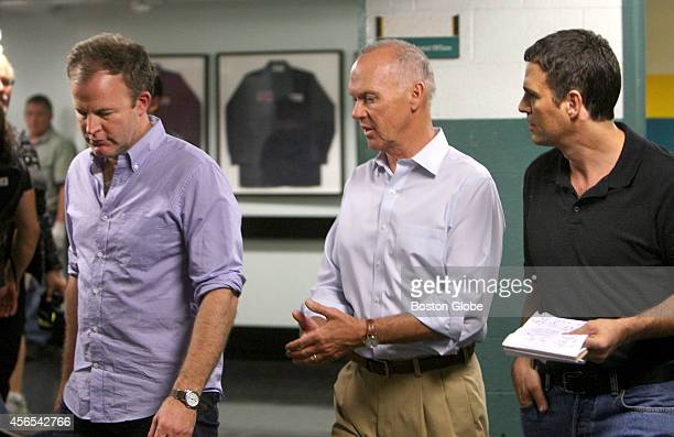 From left Director Tom McCarthy Michael Keaton and Mark Ruffalo film the Spotlight movie in the pressroom of the Boston Globe in Boston on Sept 27...