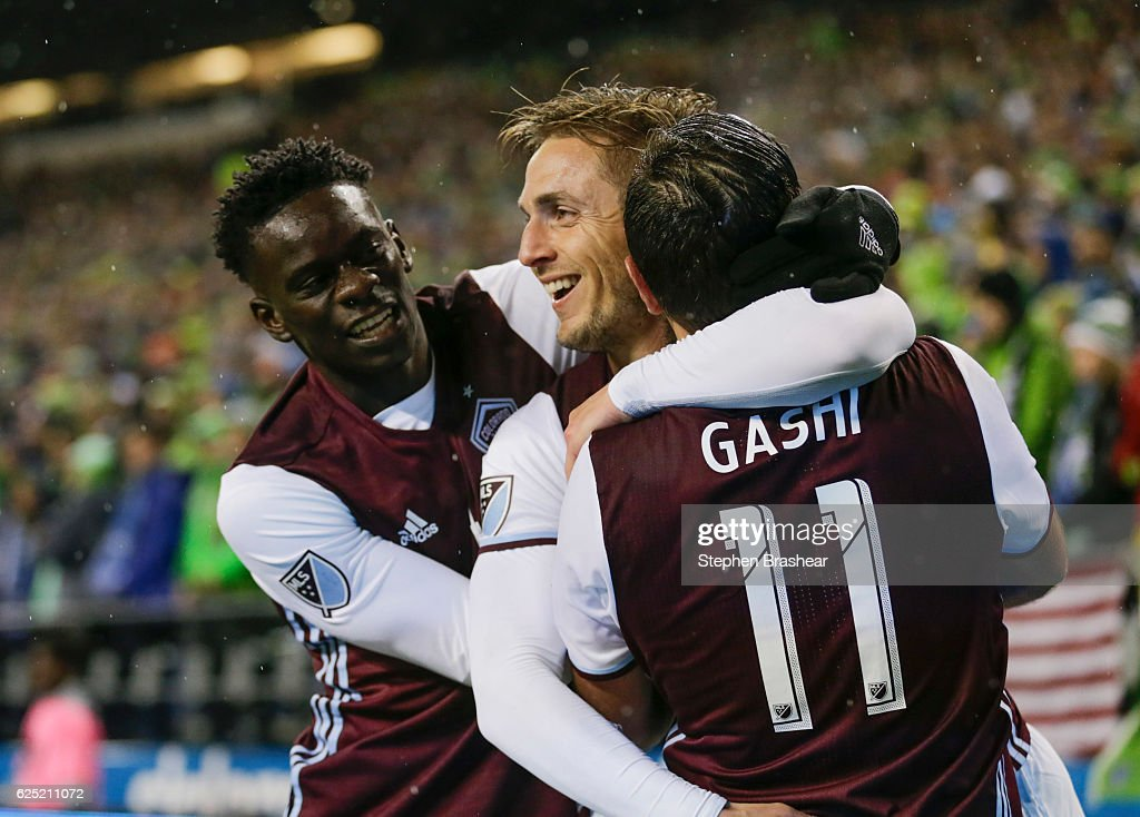 From left, Dominique Badji #14 of the Colorado Rapids, Kevin Doyle #9 of the Colorado Rapids and Shkelzen Gashi #11 celebrate a goal by Doyle during the first half of a match in the first leg of the Western Conference Finals at CenturyLink Field on November 22, 2016 in Seattle, Washington.