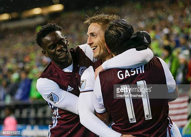 From left Dominique Badji of the Colorado Rapids Kevin Doyle of the Colorado Rapids and Shkelzen Gashi celebrate a goal by Doyle during the first...
