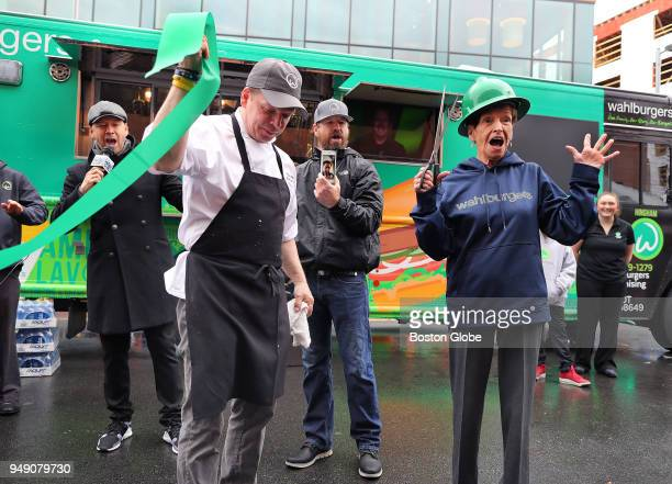 From left Donnie Paul Bob and Alma Wahlberg hold a ribboncutting to unveil their new Wahlburgers food truck at South Bay Center in the Dorchester...