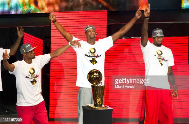 From left Dwyane Wade Chris Bosh and LeBron James of the Miami Heat celebrate their NBA world championship with their fans at the American Airlines...