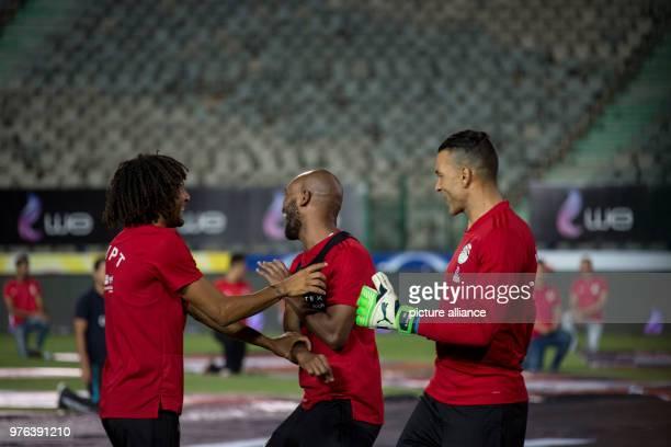 Egypt's National soccer team players Mohamed Elneny Shikabala and goalkeeper Essam ElHadary share a light moment during a training session for the...