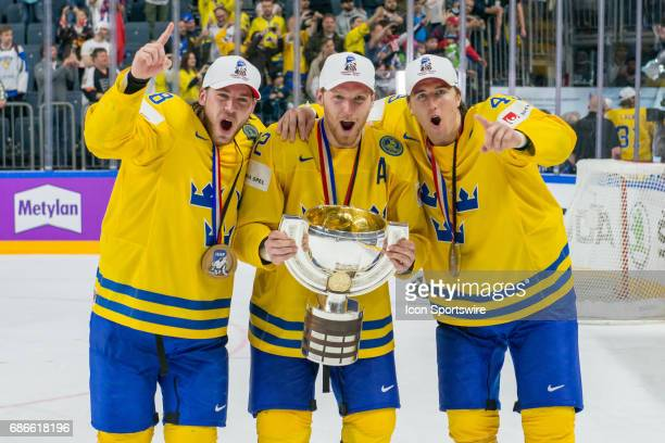 From left Elias Lindholm #92 Gabriel Landeskog and Victor Rask celebrates with the trophy during the Ice Hockey World Championship Gold medal game...