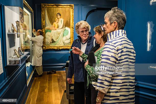 From left: Ellen Charles confers with Liana Paredes, the head curator, and Kate Markert, the executive director, as they inspect the installation of...